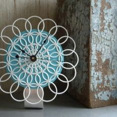 Totally diggin' the bold, yet delicate, look of this Doily Clock by And Furthermore.