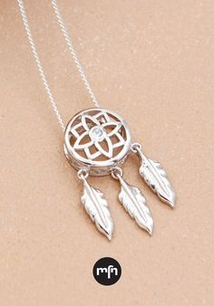 Sparkling Dreamcatcher Necklace - A beautiful artifact from the Ojibwe tribe, traditional dreamcatchers are said to protect sleepers from bad dreams by trapping nightmares. Wear this dreamcatcher necklace as your own little token of protection, using it to trap negative vibes or any harmful intentions that come your way.  Pendant measures 0.75'' long and 0.375'' wide. Necklace's adjustable chain is 16-18 inches long. Dream Catcher Necklace, Meaningful Jewelry, Bad Dreams, Dreamcatchers, Floral Design, Sparkle, Pendants, Pendant Necklace, Traditional