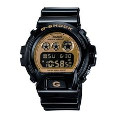 It features a black plastic and resin strap with a brown dial. It has a shock resistant construction which protects against impact and vibration.  It features an illuminator and electro-luminescent panel which allows the entire face to glow for easy reading.  It also includes a stopwatch and alarm. http://www.shadesoftime.co.uk/dw6900cb1er-casio-gshock-watch.ir