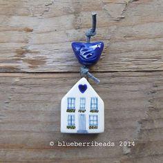 Handmade ceramic house and bird by blueberribeads on Etsy