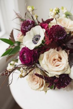 The perfect fall bouquet without the traditonal fall colours of yellow and orange. Here we use burgundy, plum, ivory and champagne blooms to create a romantic statement bouquet for a fall wedding! #calgaryweddings #calgary #calgaryweddingflorist #flowersbyjanie #burgundyflowers #pandaanemone #pompeiiroses #fallweddingcolors #fallweddingflowers