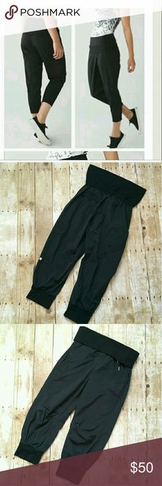 """Lululemon Athletica Dance To Yoga Pant In EXCELLENT good used condition  Size 6 Polyester & 87% nylon 13% spandex High waisted adjustable waist (folds up or down) The inseam is 21"""" and the leg opening is 5.5""""  Only been worn probably a handful of times. These are great pants, I just do not fit a LuLu size 6 anymore.  Note:There are three smallish specks up by the back waist band (can be seen in picture above) not very noticeable at all..  Please feel free to ask if you have any questions or…"""