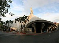 Saint Andrew the Apostle Church,  the design of this parish church in Bel-Air Makati is symbolic of the manner the martyr died crucified on an X-shaped cross. The butterfly shaped floor plan emanates from this cruciform. Many other symbolic features mark the tent-like structure, including the giant chandelier over the altar which serves as a halo over the copper cross by National Artist for Visual Art, Vicente Manansala.