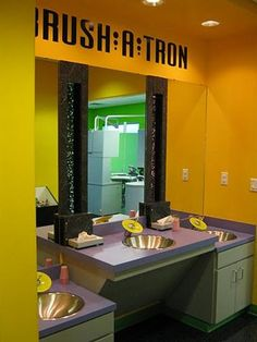 """This is the """"Brush A-Tron"""" at Smile Zone Pediatric Dentistry. Kids can learn good brushing technique here and can brush their teeth here before their appointment."""