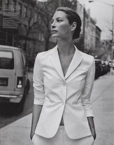 Christy Turlington in a Theory white suit for Porter Magazine.