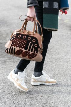 Burberry accessories AND Chanel sneakers? A perfect pairing at MFW.
