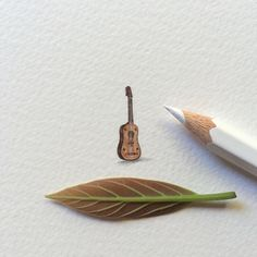 """Vihuela, inspired by Matthew Carr's """"The Devils of Cardona"""". 5 x 17 mm. I painted a miniature for each of the books released by this summer. This is the seventh and final one. Ant Art, Miniatures, Lorraine, Ants, Postcards, Arts And Crafts, Watercolor, Inspired, Drawings"""