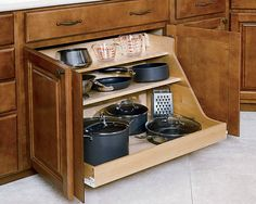 A pot-and-pan drawer with tilted shelves prevents heavy items from sliding