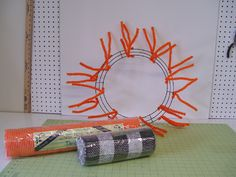 Halloween Wreath Tutorial using Metal Pumpkins, Orange Vertical Line Deco Poly Mesh, Black White Check Paper Mesh, Chevron and Polka Dot Ribbons and a new Orange Pencil Wreath in the non-metallic color.