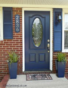 Add Great Curb Appeal to your Home with a Front Door Makeover. A beautiful front door transforms the entry to your home, adds great appeal and gives a pop of color to an otherwise bland and boring entry. This project for my front door makeover is one tha Front Door Paint Colors, Painted Front Doors, Blue Front Doors, House Front Door, House Doors, Front Porch, Navy Shutters, Paint Shutters, Tan House
