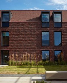 Walters & Cohen covers English boarding house in rusty red tiles