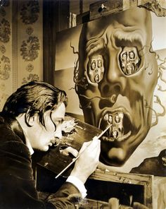 Salvador Dali painting painting a picture at his house in Portilligat.
