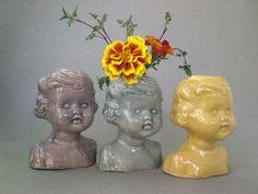 Baby doll head vases.  Cone 5 stoneware, 2014