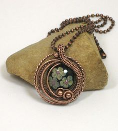 Floral lampwork bead with woven copper wire framed pendant   BDJDesigns - Jewelry on ArtFire