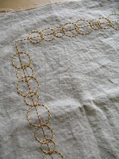 Obsessed with the rounded circular shape. Golden Circles Table Runner | Flickr