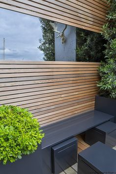 Tiny roof terrace   Bench with pull-out stools on tiny urban balcony with a spectacular view across London   Charlotte Rowe Garden Design