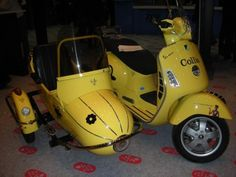 Yellow Vespa and sidecar