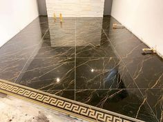 This luxurious tile is from the Versace Marble collection. The striking gold marble vein effect in this Nero tile certainly looks stunning against the black. Versace Tiles, Floor Patterns, Gold Marble, Greek Key, First Home, Tile Floor, Bathrooms, Flooring, Interior Design