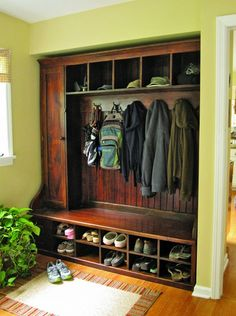 Could build a cabinet like this at the front door entryway (probably painted white) to store shoes etc.? (Or in laundry room in place of storage cabinets in there currently).