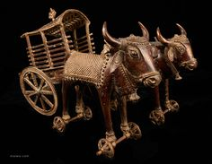 A team of oxen from the south of India pull a cart. This is a masterful piece of sculpture consisting of several individually made items fitted together. It's exact provenance has been lost, however, such items could have been made as a plaything for the Raj's children in one of India's princely states.