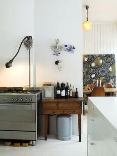 I love this kitchen, especially the painting in the background.