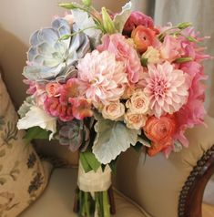 Wedding bouquet by designer Karen Lipkin from Blossoms and Branches - Chicago, Illinois, with succulents, peach dahlias, peach lisianthus, cockscomb, orange ranunculus, spray roses and dusty miller