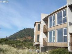 Rockaway Beach, OR: Pristine views of the beach, surf and Neah-Kah-Nie Mountain grace this wonderfully unique oceanfront home with 8 bedrooms and 8 baths for up to 24 gue...