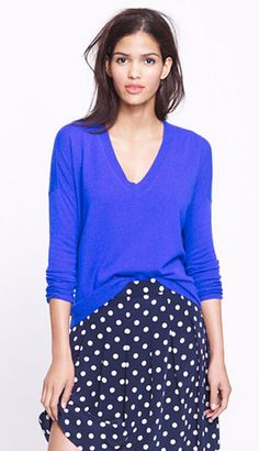 bright blue boyfriend sweater and navy skirt with polka dots @J.Crew