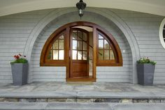 This could be a Hobbit's front door in the Shire. Greenwich, CT.  http://www.estately.com/listings/info/7-little-cove-place