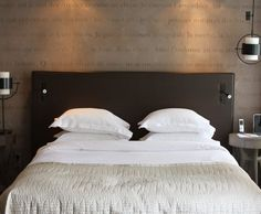 Taupe walls made to feel more velvety with purple/grey linens ...
