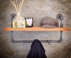 Hey, I found this really awesome Etsy listing at http://www.etsy.com/listing/179446822/industrial-coat-rack-with-reclaimed-wood