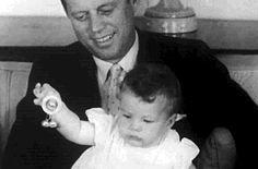 John F. Kennedy with daughter Caroline, 1958.