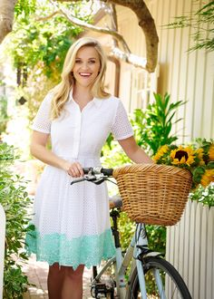All eyes on eyelet! (Though they'll be looking at the lace, too.) We combined two of our prettiest, summeriest fabrics to create this special piece: A classic shirtdress in unexpected eyelet with a full, flouncy skirt trimmed with intricate contrast lace. Get ready for a whole lotta compliments, y'all. | Reese Witherspoon | Draper James