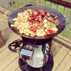 Party time!  The best of both worlds...a wok and a grill.  Grilling on the Twok Grill
