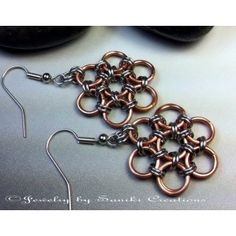 A chainmaille weave from the Orient.  Japanese 12in2 Chainmaille Weave. A classic chainmaille weave design with your choice of 18 gauge metal on Surgical Steel fishhook earwires.