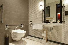 Motionspot design and supplyaccessible hotel bathrooms that can be quickly and flexibly...