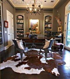 Driven By Décor: Cowhides Layered Over Natural Fiber Rugs