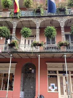 New Orleans French Quarter charm, wrought iron accents and railings frame simple doors and windows, and offer the perfect place to hang baskets of greenery.