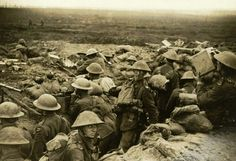 A signals section of the 13th (Service) Battalion, Durham Light Infantry, equipped with telescopes, field telephone and signalling lamps, watch the battalion's advance on Veldhoek on 20 September 1917. Battle of the Menin Road.