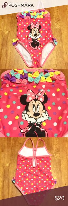 NEW❗️🎀Disney Minnie Mouse Colorful Swimsuit🎀 🎀Disney Minnie Mouse Colorful Swimsuit🎀 Pinkish-Coral color w/ colorful polkadots • Features Minnie Mouse on the front • Yellow, Pink & Purple bows on each side of the bathing suit w/ tons of bows along the top • The back has a keyhole & also has a piece that moves up & down to adjust where you want the straps to be. Maybe worn once? Not even sure! 🎀🤗EXCELLENT CONDITION!!! Absolutely adorable!!🤗🎀 Disney Swim One Piece