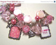 ON SALE BREAST Cancer Awareness Inspired Altered Art Charm Bracelet Handmade Beaded. $27.00, via Etsy.