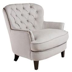 Button-tufted club chair with nailhead trim and hardwood frame.Product:  Club chair Construction Material:  Hardwood frame and linen upholstery     Color:  Natural and espresso  Features:  Diamond tufted back  Padded seat and back for easy relaxation  Nailhead trim  Dimensions:  34.6 H x 33.7 W x 34.6 D Note: Assembly required