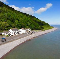 Talk about on the seafront; Seagulls Rest in Minehead, Somerset, is a holiday cottage right on the Minehead seafront. Self catering accommodation for 7 guests. Somerset, Seaside, Stuff To Do, Coastal, Scenery, England, Cottage, Beach, Water