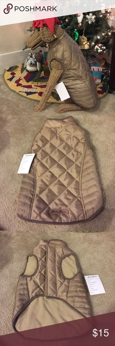 Eddie Bauer Large Dog Coat Super cute Dog coat that's wayy to small for my dog. I completely underestimated how fat my dog is  it's a size large sample! Eddie Bauer Other