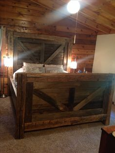 Reclaimed barn door hand hewn rustic log cabin bed. We can custom build a piece for you! Check out our FB page