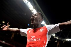 The Arsenal forward holds his arms aloft in celebration after his first career hat-trick a...