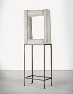 Isa Genzken B. 1948 FENSTER concrete and steel 225 by 80 by 48cm.; 88 5/8 by 31 1/2 by 18 7/8 in. Executed in 1990.