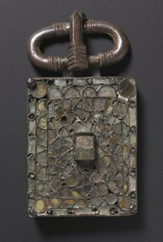 Belt Buckle Bronze and glass, Overall - h:12.80 w:6.70 d:2.40 cm (h:5 w:2 5/8 d:15/16 inches). Gift of Joe Hatzenbuehler 2007.228 Cleveland Museum of Art Date: c 525-560