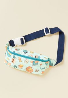 Show the love to your pals by sharing some space in your Mokuyobi fanny pack! Dancing atop its icy blue base hue is an abstract print of teapots, vases, squiggles, bowls of fruit. Once pals are done wiggin' out over the exterior's awesomeness, they'll want to take a peek at this USA-made pouch's neon coral interior to see where their stuff can fit in. Now the fun can really begin!