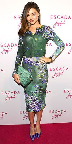 MIRANDA KERR | Bouquets wilt, but the supermodel's wildflower-patterned pencil skirt and coordinating cardigan (both Escada) are forever. (Or, at least until she has to return it to the design house following their Joyful fragrance event in Munich.)